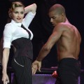 Madonna performs on stage during her 'MDNA' tour with dancer Brahim Zaibat in Tel Aviv, Israel on May 31, 2012