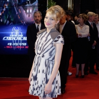 Emma Stone reveals a black and white print dress styled with a loose, pulled-back bun at the 'The Amazing Spider-Man' premiere in Seoul, South Korea on June 14, 2012