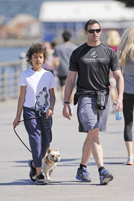 Hugh Jackman and son Oscar take their dog, Peaches, on a walk along the Hudson River Parkway in New York City on June 16, 2012