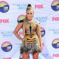Demi Lovato arrives in a daring mesh Falguni & Shane dress with metallic embellishments at the 2012 Teen Choice Awards at Gibson Amphitheatre in Universal City, Calif., on July 22, 2012