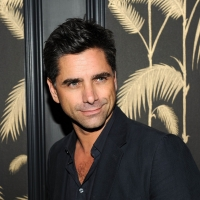 John Stamos smiles for the camera at the after party for the Cinema Society's screening 'Killer Joe' at No. 8 in New York on July 23, 2012