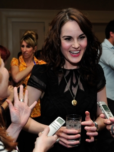 Michelle Dockery speaks with reporters after the 'Downton Abbey' panel at the TCA summer tour 2012 at the Beverly Hilton Hotel, July 21, 2012