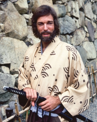 Richard Chamberlain, US actor, wearing a kimono and holding a samurai sword in a publicity portrait issued for the US television series, &#8216;Shogun&#8217;, Japan, 1980. The mini-series, adapted from the novel by James Clavell, starred Chamberlain as &#8216;Pilot-Major John Blackthorne&#8217;