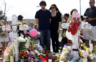 Christian Bale and his wife Sandra Blazic pay their respects at the memorial across the street from the Century 16 movie theater in Aurora, Colorado on July 24, 2012