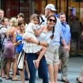 A smiling Katie Holmes and Suri Cruise leave the Museum of Modern Art in New York City, August 6, 2012