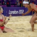 Kerri Walsh and Misty May-Treanor and celebrate at the end of the women Beach Volleyball final match against April Ross and Jennifer Kessy at the London 2012 Olympic Games on August 08, 2012