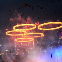 Freshly 'forged' Olympic Rings fly above the chimneys during The Age of Industry scene in the opening ceremony of the London 2012 Olympic Games at the Olympic Stadium in London on July 27, 2012
