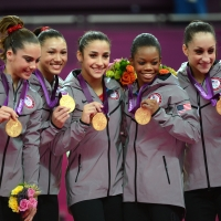 Gold medalist Team US Mckayla Maroney, Kyla Ross, Alexandra Raisman, Gabrielle Douglas and Jordyn Wieber celebrate  at the 02 North Greenwich Arena in London on July 31, 2012