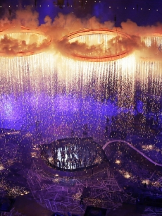 Rings representing both the Olympics and the Industrial Revolution are lit and lifted during the Opening Ceremony of the London 2012 Olympic Games at the Olympic Stadium in London on July 27, 2012