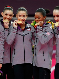 McKayla Maroney, Kyla Ross, Aly Raisman, Gabrielle Douglas and Jordyn Wieber of Team USA celebrate after winning the gold medal in the Artistic Gymnastics Women's Team final at the London 2012 Olympic Games on July 31, 2012