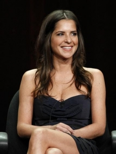 Kelly Monaco sits on stage for the 'General Hospital' panel at the Television Critics Association summer tour, at the Beverly Hilton Hotel, Beverly Hills, July 26, 2012