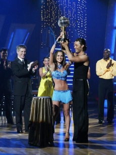Kelly Monaco and Alec Mazo hoist up the mirrorball after winning Season 1 of 'Dancing with the Stars'