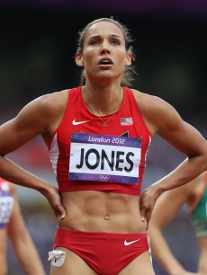 Lolo Jones of the United States looks on at the scoreboard in anticipation after competing in the Women's 100m Hurdles Semifinals on Day 11 of the London 2012 Olympic Games at Olympic Stadium on August 7, 2012