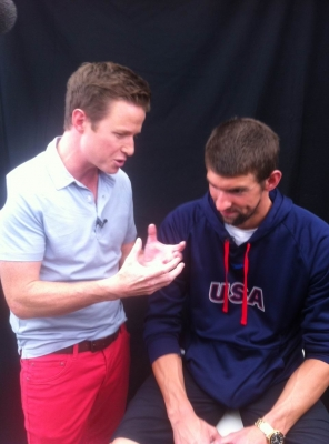 Billy Bush and U.S. swimmer Michael Phelps chat together at the 2012 Summer London Olympics on July 25, 2012