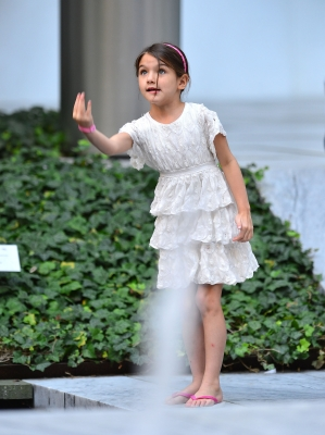 Suri Cruise plays at the Museum of Modern Art in NYC, August 6, 2012