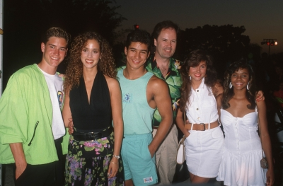 Mark-Paul Gosselaar, Elizabeth Berkley, Mario Lopez, Dennis Haskins, Tiffani-Amber Thiessen and Lark Voorhies of 'Saved by the Bell' gather around for a cast picture at the Century Plaza Hotel in Century City, Calif., on July 19, 1990.