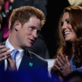 Prince Harry of Wales and Britain's Catherine, Duchess of Cambridge, applaud in the stands of the Olympic stadium during the closing ceremony of the 2012 London Olympic Games in London on August 12, 2012