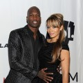 Chad Johnson and Evelyn Lozada pose at the Maxim Party Powered by Motorola Xoom at Centennial Hall at Fair Park on February 5, 2011 in Dallas