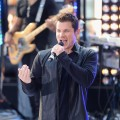 Nick Lachey performs with 98 Degrees on the 'Today' show at Rockefeller Plaza in New York City on August 17, 2012