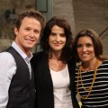 Cobie Smulders poses with Billy Bush and Kit Hoover on Access Hollywood Live on August 28, 2012
