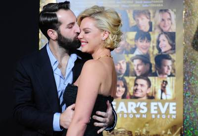 Josh Kelley stealing a kiss from Katrherine Heigl on arrival for the film premiere of 'New Year's Eve' at Grauman's Chinese Theater in Hollywood on December 5, 2011