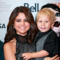 Selena Gomez and Jaxon Bieber attend the 'Hotel Transylvania' premiere during the 2012 Toronto International Film Festival on September 8, 2012