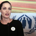 Angelina Jolie briefs the press during her visit to the Zaatari refugee camp near the Jordanian border with Syria, on September 11, 2012