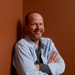 Joss Whedon of &#8216;Much Ado About Nothing&#8217; poses at the Guess Portrait Studio during 2012 Toronto International Film Festival on September 9, 2012 in Toronto