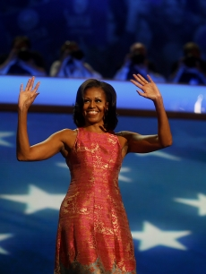 First Lady Michelle Obama waves before speaking at the Democratic National Convention (DNC) in Charlotte, North Carolina, U.S., Sept. 4, 2012