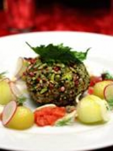 Chef Joachim Splichal&#8217;s Smoked salmon avocado sphere, crisp vegetables with fresh hearts of palm, cucumber apple, red radish with an heirloom tomato vinaigrette