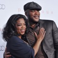 Oprah Winfrey and director/actor Tyler Perry arrive at the Los Angeles Premiere 'Precious: Based On The Novel Push By Sapphire' at Grauman's Chinese Theatre, Hollywood, on November 1, 2009