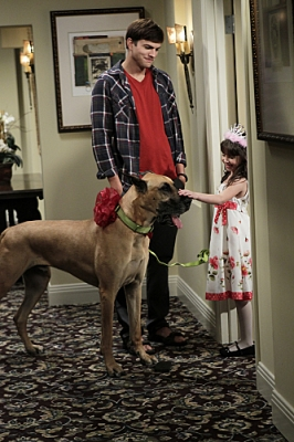 Walden (Ashton Kutcher, left) brings Zoey's daughter, Ava (Talyan Wright, right) a surprise for her birthday, on 'Two and a Half Men'