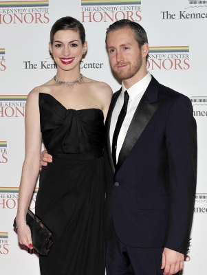 Anne Hathaway and Adam Shulman arrive for the formal Artist's Dinner honoring the recipients of the 2011 Kennedy Center Honors hosted by United States Secretary of State Hillary Rodham Clinton at the U.S. Department of State, Washington, D.C., December 3, 2011