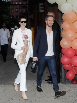 Anne Hathaway and fiance Adam Shulman attend the Stella McCartney Spring 2012 Presentation at Stella McCartney Store, New York City, on June 11, 2012