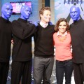 Billy Bush and Kit Hoover pose with The Blue Man Group on Access Hollywood Live on October 11, 2012