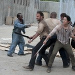The gang fend off zombies on the Season 3 premiere of 'The Walking Dead'