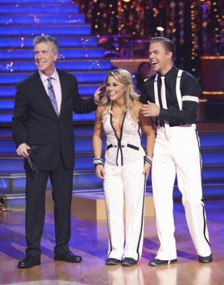 Tom Bergeron stands with Shawn Johnson and Derek Hough as they listen to the judges during Week 3 of 'Dancing With The Stars: All-Stars,' Oct. 8, 2012