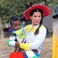 Sandra Bullock takes on &#8216;Toy Story&#8217; as cowgirl Jessie, and totes around her own Buzz Lightyear son Louis, as they celebrate Halloween in Los Angeles on October 31, 2012