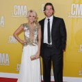 Carrie Underwood and husband Mike Fisher attend the 46th annual CMA Awards at the Bridgestone Arena in Nashville on November 1, 2012 