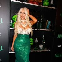 Kim Kardashian rocks a mermaid costume at the 2nd annual Midori Green Halloween party at Avenue in New York City on October 27, 2012
