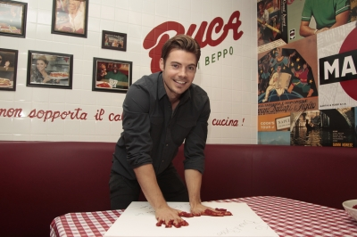 'Dallas' hunk Josh Henderson celebrates his birthday at Buca di Beppo in Mesquite, Texas, where he was immortalized in marinara sauce following the meal on October 21, 2012