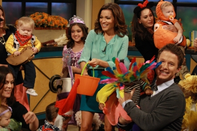 Billy Bush and Kit Hoover pose with some of the kids and the parents who took part in the Access Hollywood Live Halloween kids costume show
