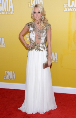 Carrie Underwood rocks the red carpet in a beautiful white gown at the 46th annual CMA Awards at the Bridgestone Arena in Nashville Tennessee, on November 1, 2012