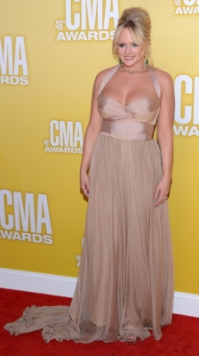 Miranda Lambert looks sexy in a nude halter dress at the 46th annual CMA Awards at the Bridgestone Arena on November 1, 2012 in Nashville, Tennesse 