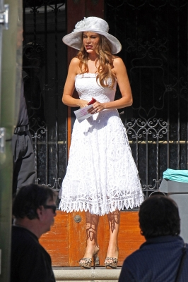 Sofia Vergara looking glamorous in a white dress and hat — and without her faux baby bump — on the set of 'Modern Family' in Los Angeles on November 5, 2012