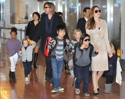 Brad Pitt, Angelina Jolie and their six children Maddox, Pax, Zahara, Shiloh, Knox, and Vivienne arrive at Haneda International Airport in Tokyo on November 8, 2011
