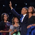 President Barack Obama, First Lady Michelle and daughters Sasha and Malia wave to supporters on election night in Chicago on November 6, 2012