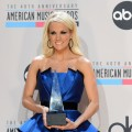 Carrie Underwood poses with the Favorite Country Music Album for &#8216;Blown Away&#8217; in the press room at the 40th American Music Awards held at Nokia Theatre L.A. Live in Los Angeles on November 18, 2012 