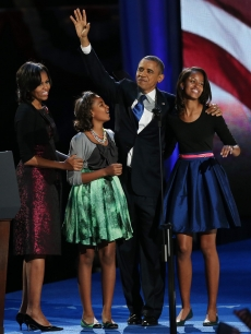 President Barack Obama walks on stage with first lady Michelle Obama and daughters Sasha and Malia to deliver his victory speech on election night at McCormick Place November 6, 2012 in Chicago