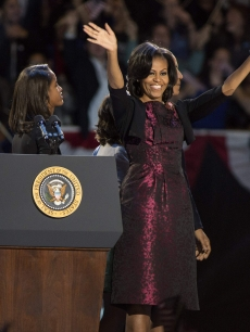 : Malia Obama and first lady Michelle Obama appear after Obama's victory speech on election night at McCormick Place on November 6, 2012 in Chicago